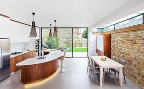 个性化椭圆形橱柜开放式厨房装修效果图